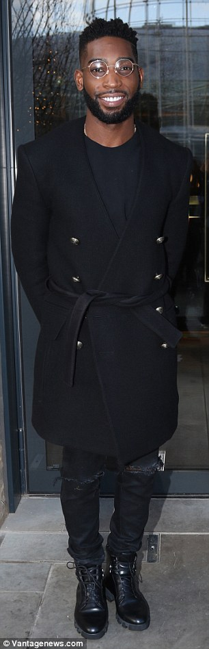 Cool chap: They were in good company on the day as they were joined by rapper Tinie Tempah who wore a pea coat, skinny jeans and military-style boots