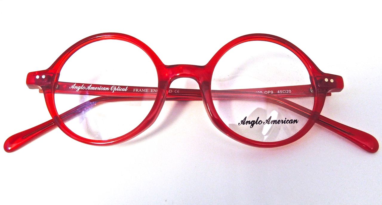 4263a372aea A round style with a modern twist. The red makes these frames really pop!