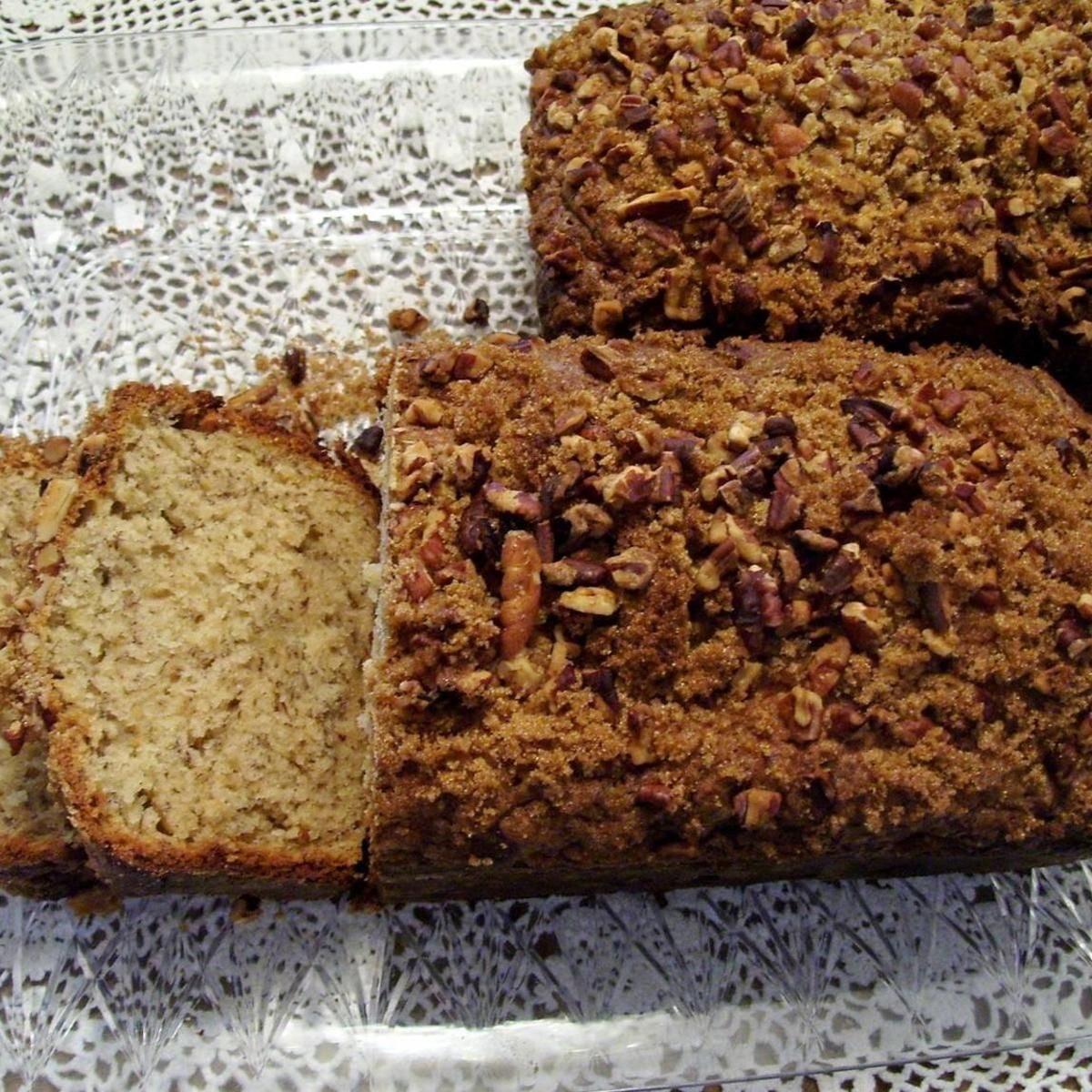 I have found this recipe to be very moist.  It makes ordinary banana bread a special treat.  Hint: Create layers.  Pour 1/4 of the batter in the pan, add the pecans & brown sugar, then top with a little more batter, and more topping for a layered effect.  You layer it in the pan, and it becomes a wonderful surprise to the ordinary banana bread we have all come to know.   The photo is not layered... my oops.  I forgot about it until I got to the pecans, but it sure didn't hurt the flavor.