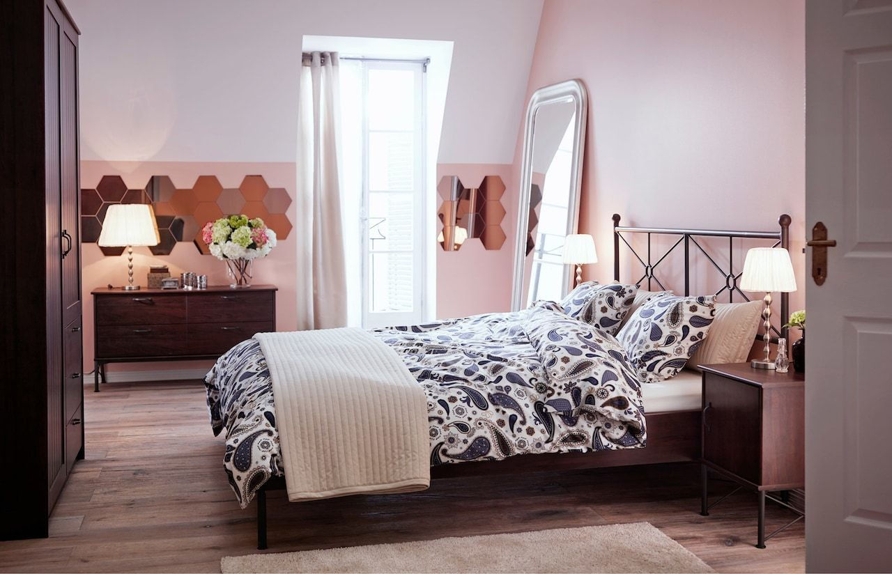 bedroom with ikea furniture mirrored wall tiles rug