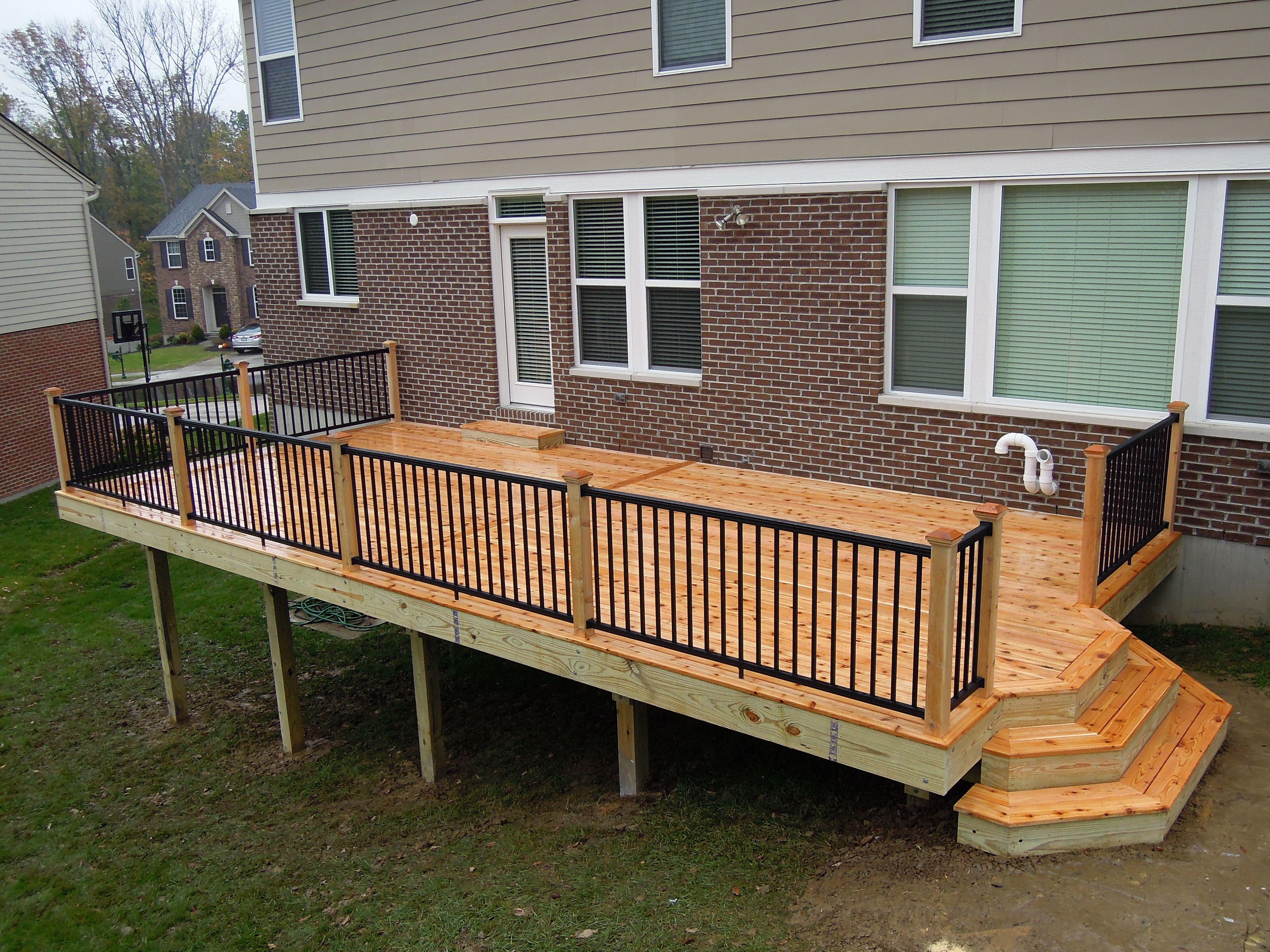 Western Red Cedar Deck With Black Aluminum Railing And Custom