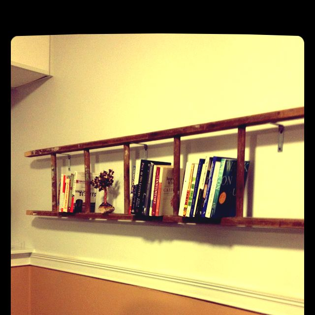"""Hung this old ladder for a bookshelf. Super easy & looks great! ( used """"L"""" brackets to hang.)"""