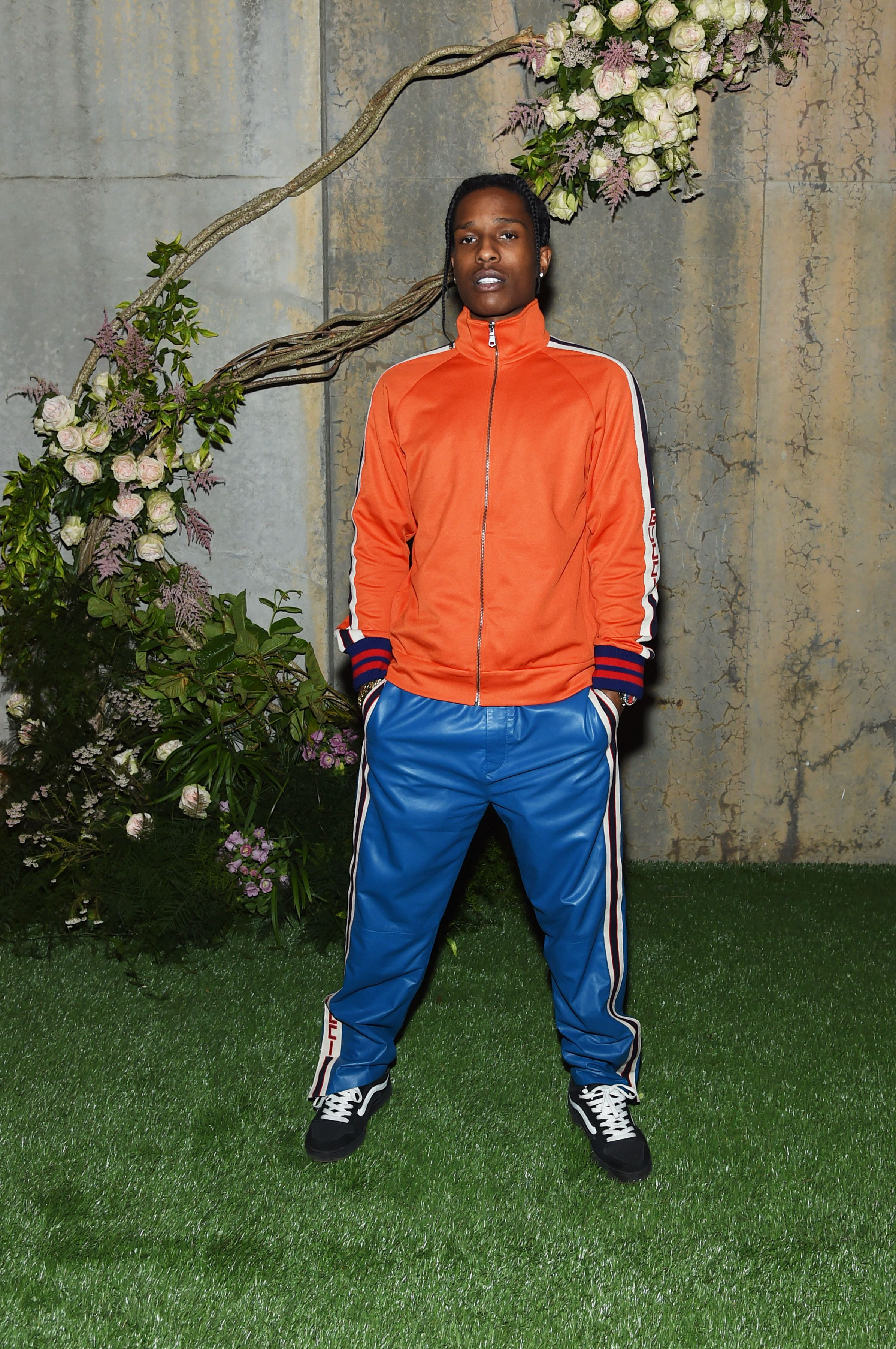 A$AP Rocky wears leather tracksuit pants and jacket from Gucci Pre-Fall 2017.