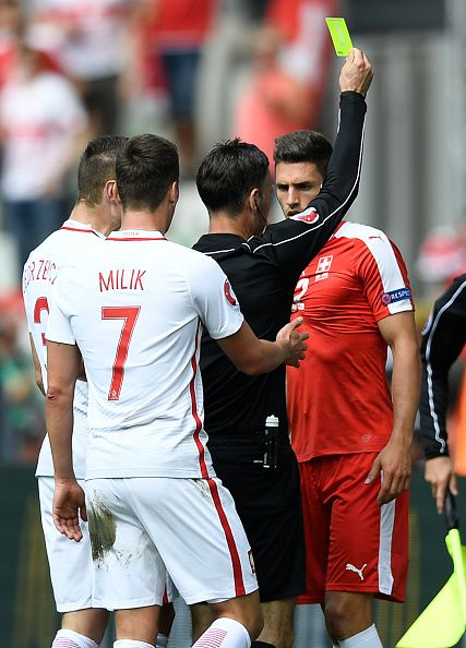 Euro2016 English Referee Mark Clattenburg Gives Switzerland S Defender Fabian Schaer A Yellow Card After A Tackle During The Euro 2016 Round Of Six Fabian Schar