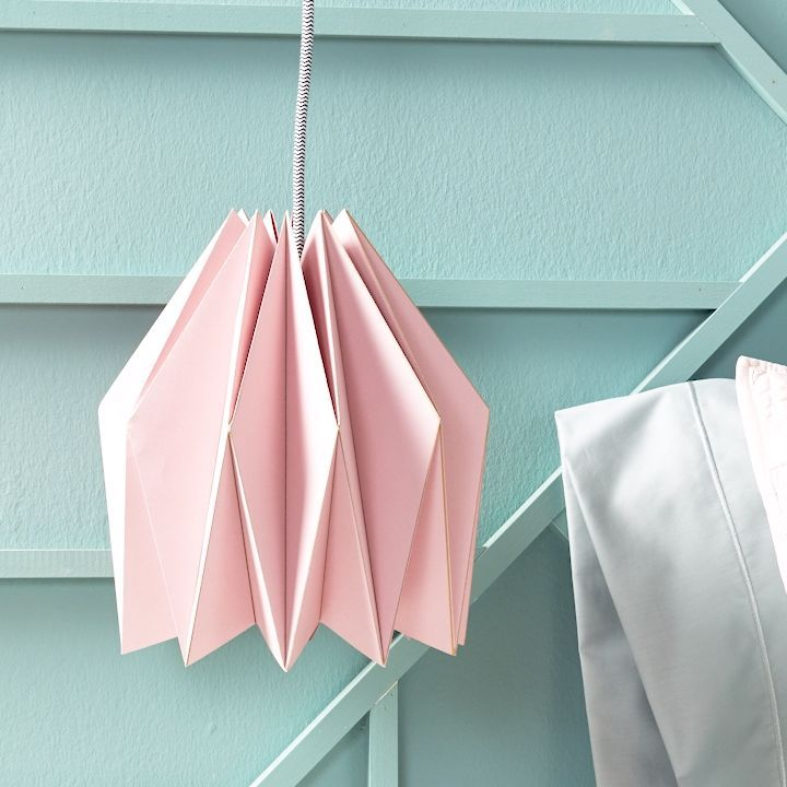 Learn how to make this affordable geometric lampshade, then hang your modern lighting in a bedroom, dining room, or office. #origami