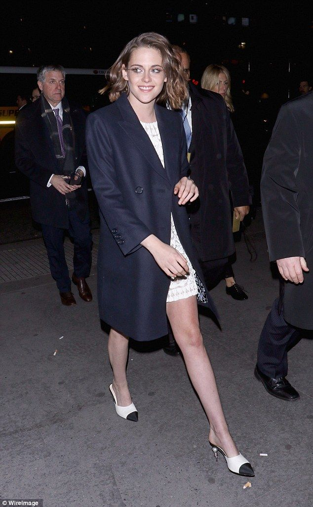 Easy style: Kristen bared covered up despite the winter climate as she arrived...
