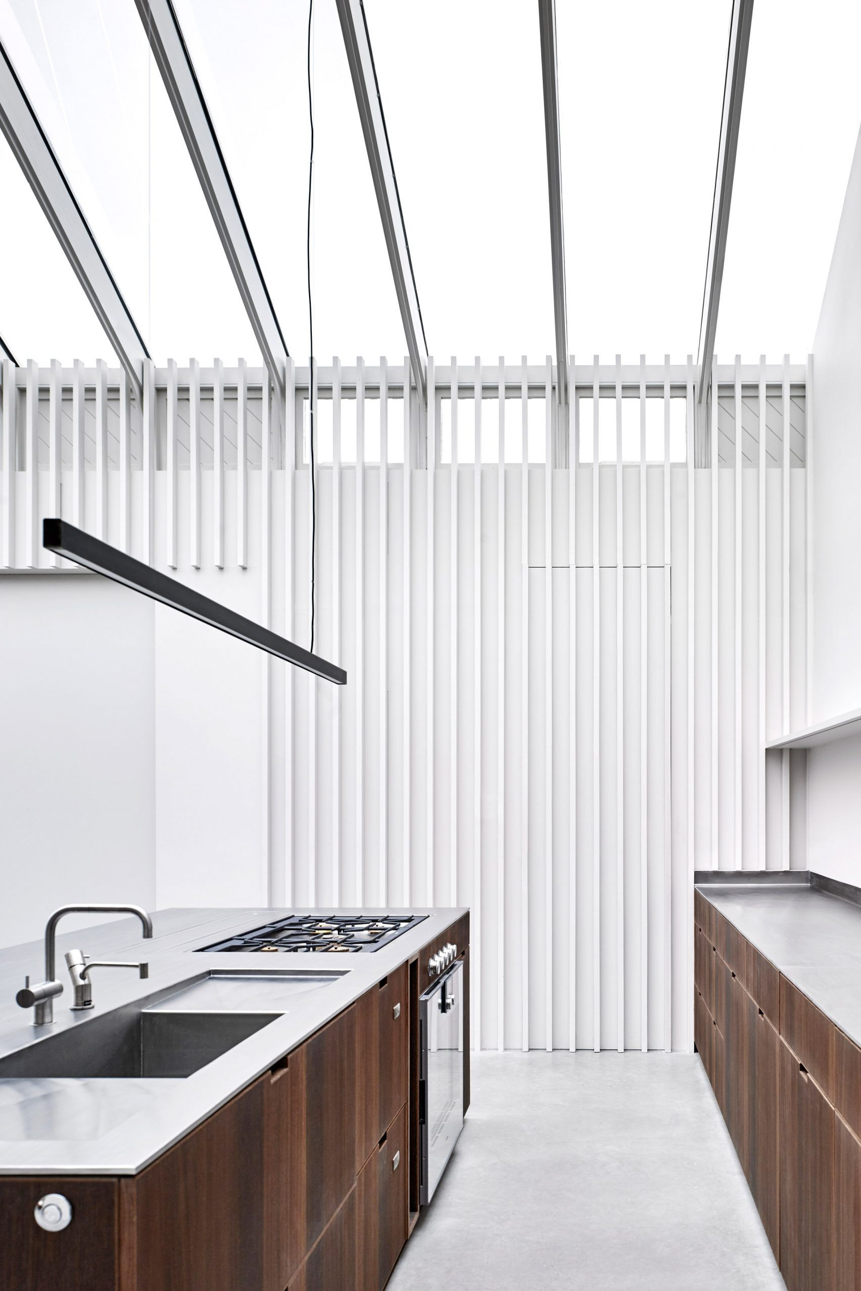 McLaren Excell Contrasts Smoked Oak With White Panelling For London