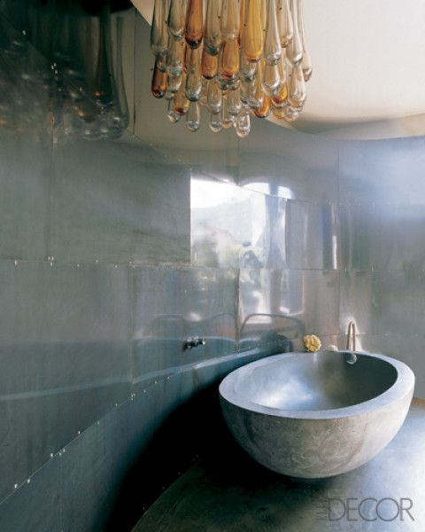 Bathroom inspiration, love the vintage 1950's italian hand-blown light, concrete egg tub, and sheet metal paneled walls