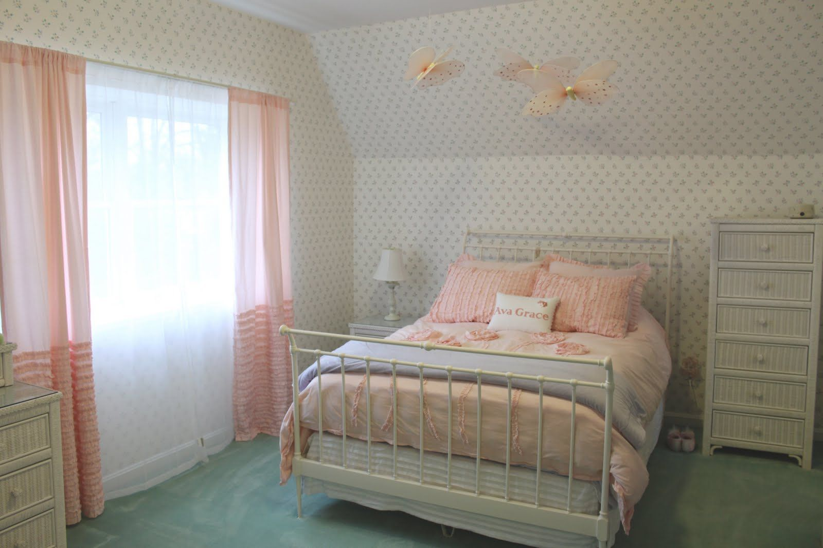 Wonderful Bedroom Designs In Peach And White Color : Beautiful Peach and White Bedroom Design with Minimalist Iron Single Size Bed and Peach Transparent Curtain also Butterfly Hanging Ornament