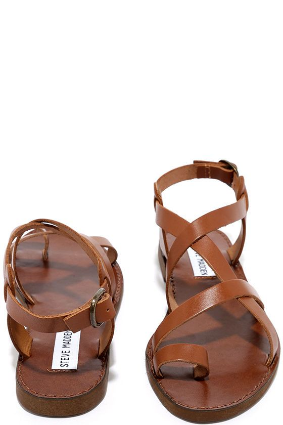 Tackle the warm season with a wonderfully cute sandal like the Steve Madden Agathist Cognac Leather Flat Sandals! Strappy leather upper includes a toe loop and adjustable ankle strap (with antiqued brass buckle).