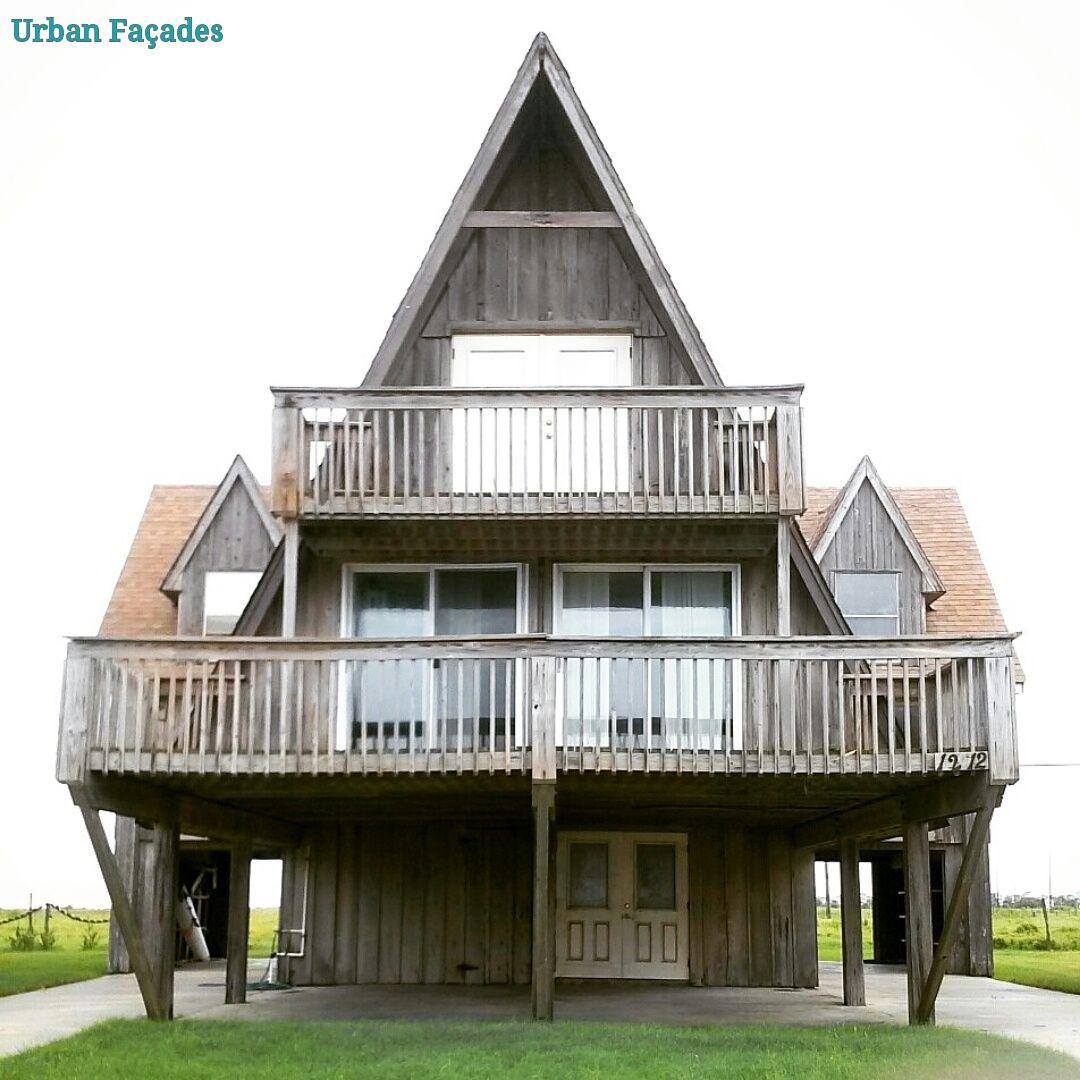 Loving this stilt raised wooden beach house built in 1962 for Stilt home builders