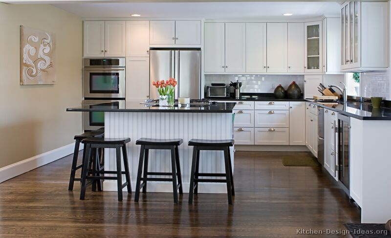 Kitchen Design White Cabinets Stainless Appliances white shaker cabinets, black countertop, subway tile, walnut floor