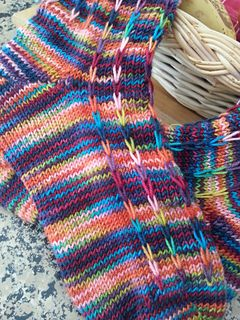The long slipped stitches in this pattern help break up pooling in hand dyed yarns, and create a faux-ribbed effect.