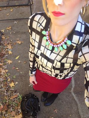 statement necklace, black and white blouse and raspberry skirt