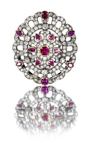 A diamond and ruby brooch/pendant, circa 1880