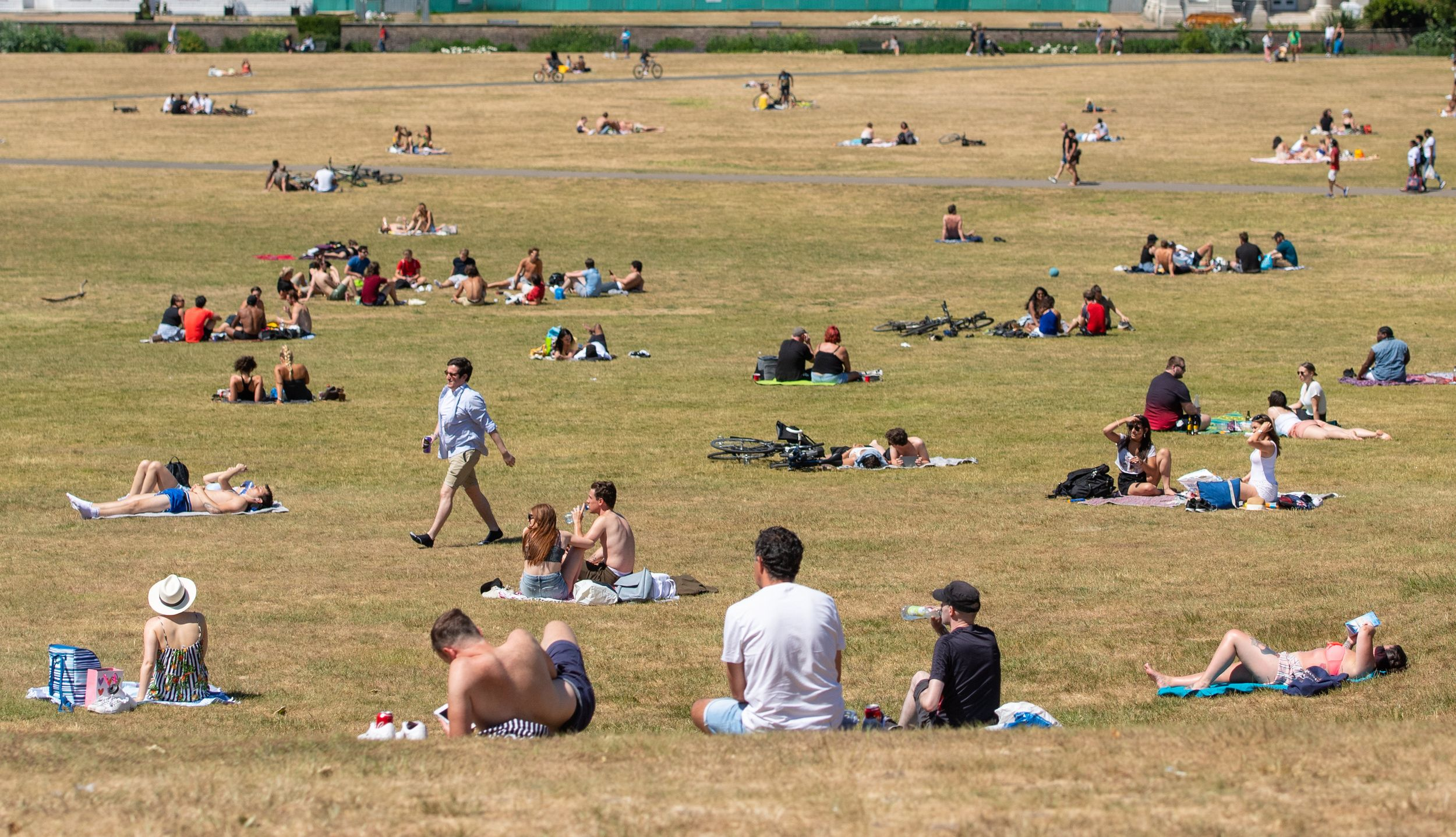 People enjoying the good weather in Greenwich Park, south