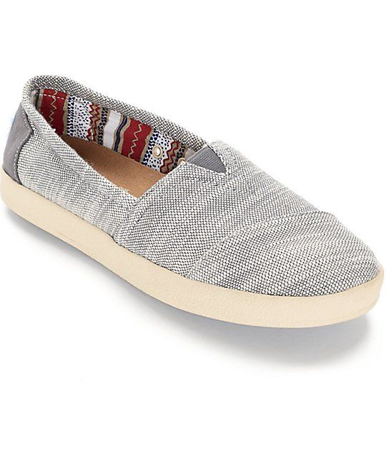 The Avalon shoes by Toms feature a convenient slip-on design thanks to an elastic V on the top of a grey and white textured woven low-profile upper and a multicolor tribal print lining to give these Women's shoes a stylish accent.