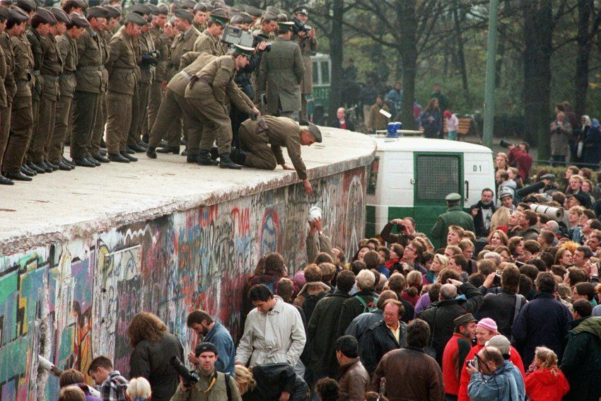 East German Border Guards standing on the Wall