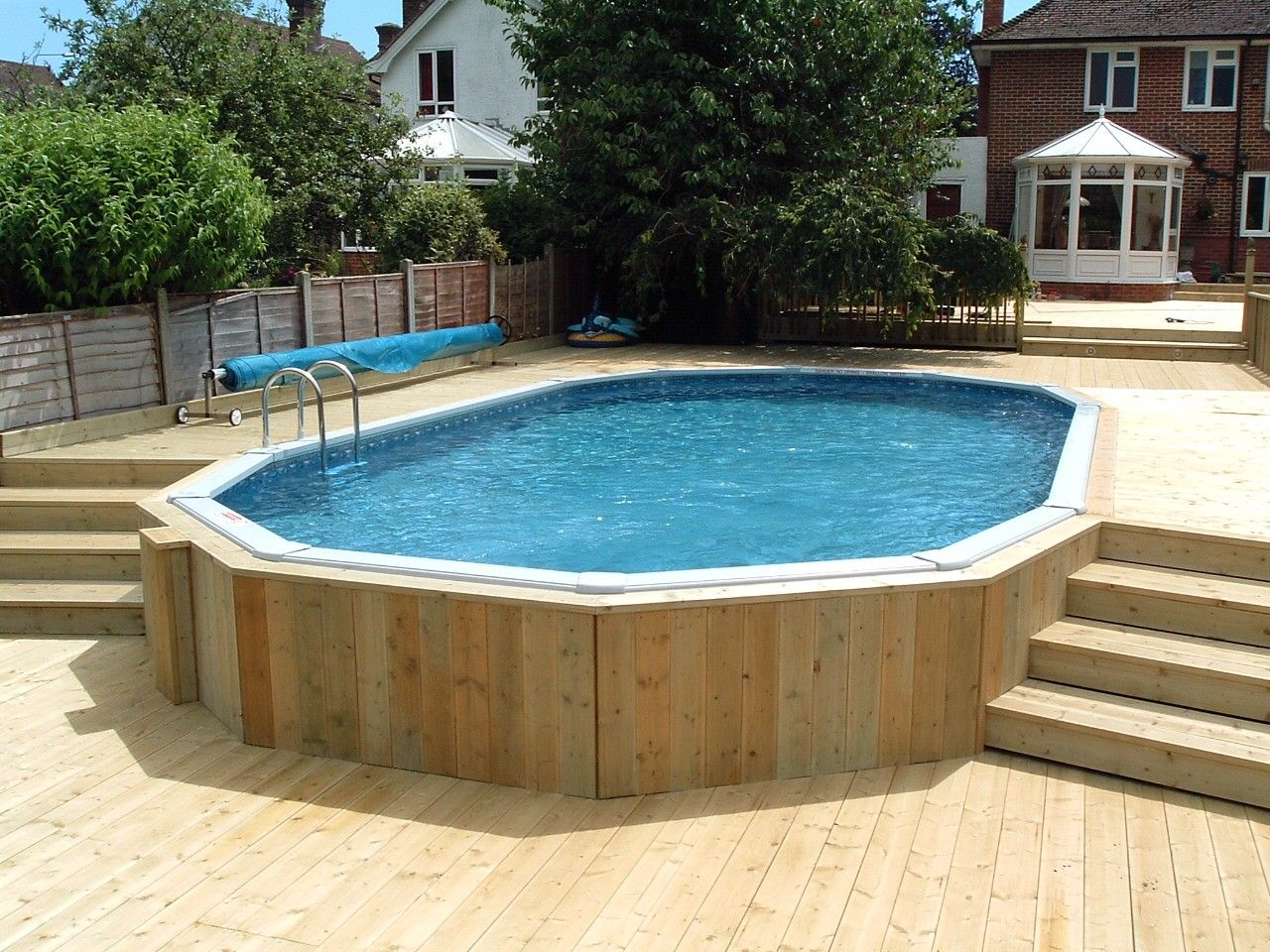 Pool decks above ground pictures - 30 X 15 Aluminium Above Ground Pool With Decking Surround