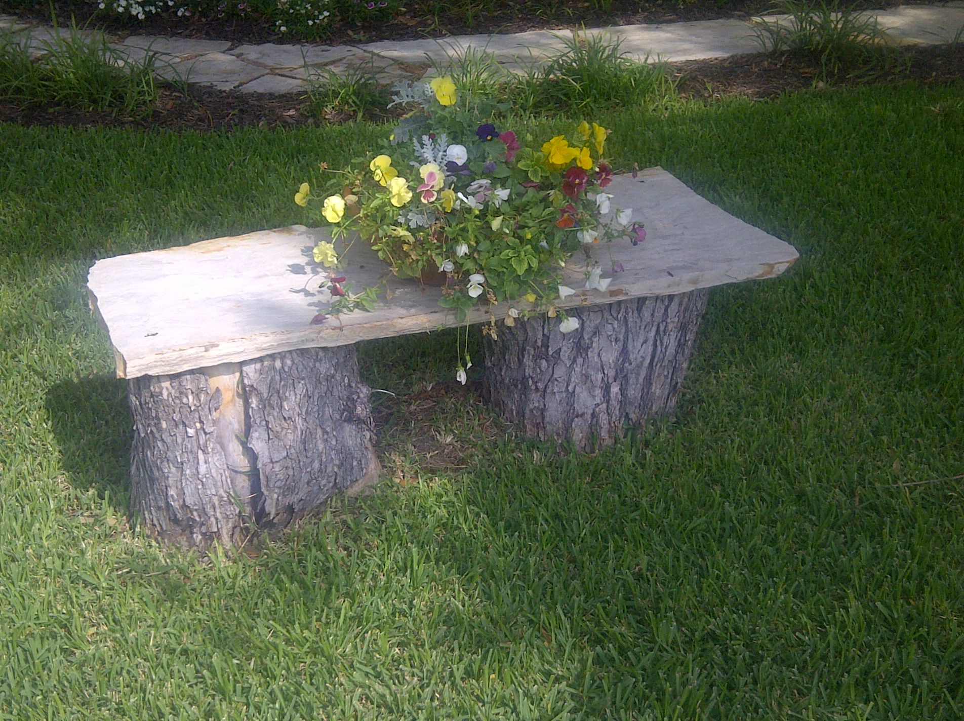 Tree stump and flagstone bench I made for the front yard