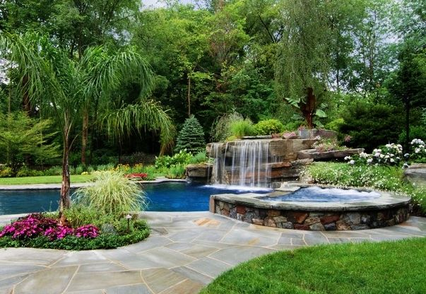 Pool Waterfall Ideas pool rock the gazebo built in the poolside across the waterfalls is perfect for the homeowner to create a stress free zone in the house fountain features Pools Classy Pool Landscaping Ideas With Pretty Pool Waterfall Colorful Flowers In Concrete Planter Small