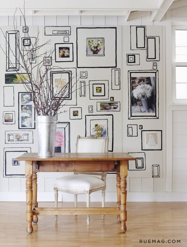 "Graham & Brown's ""Frames"" wallpaper, in an image from Rue, is particularly fun to customize because you can color it and add photos and artwork to the frames."