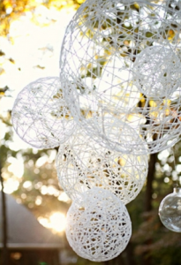 DIY stringed globes: I've made a few of these before...could make them bigger to hang outside for the party!