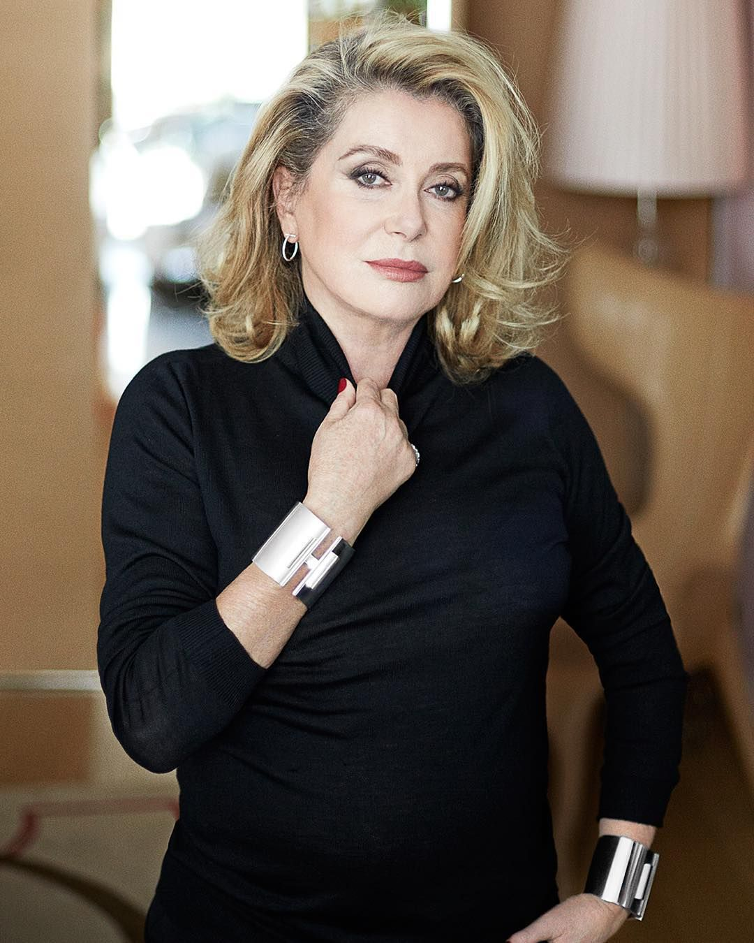 ba0bfc8c4ab7f The stunning Catherine Deneuve wears Tiffany T wire diamond hoop ...