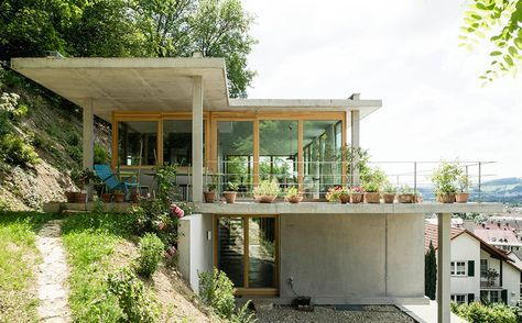 gian salis builds a house on a slope in southern germany is part of Hillside house - at germany's southernmost tip, architect gian salis has built a twostorey home on an inclined site overgrown with wildlife