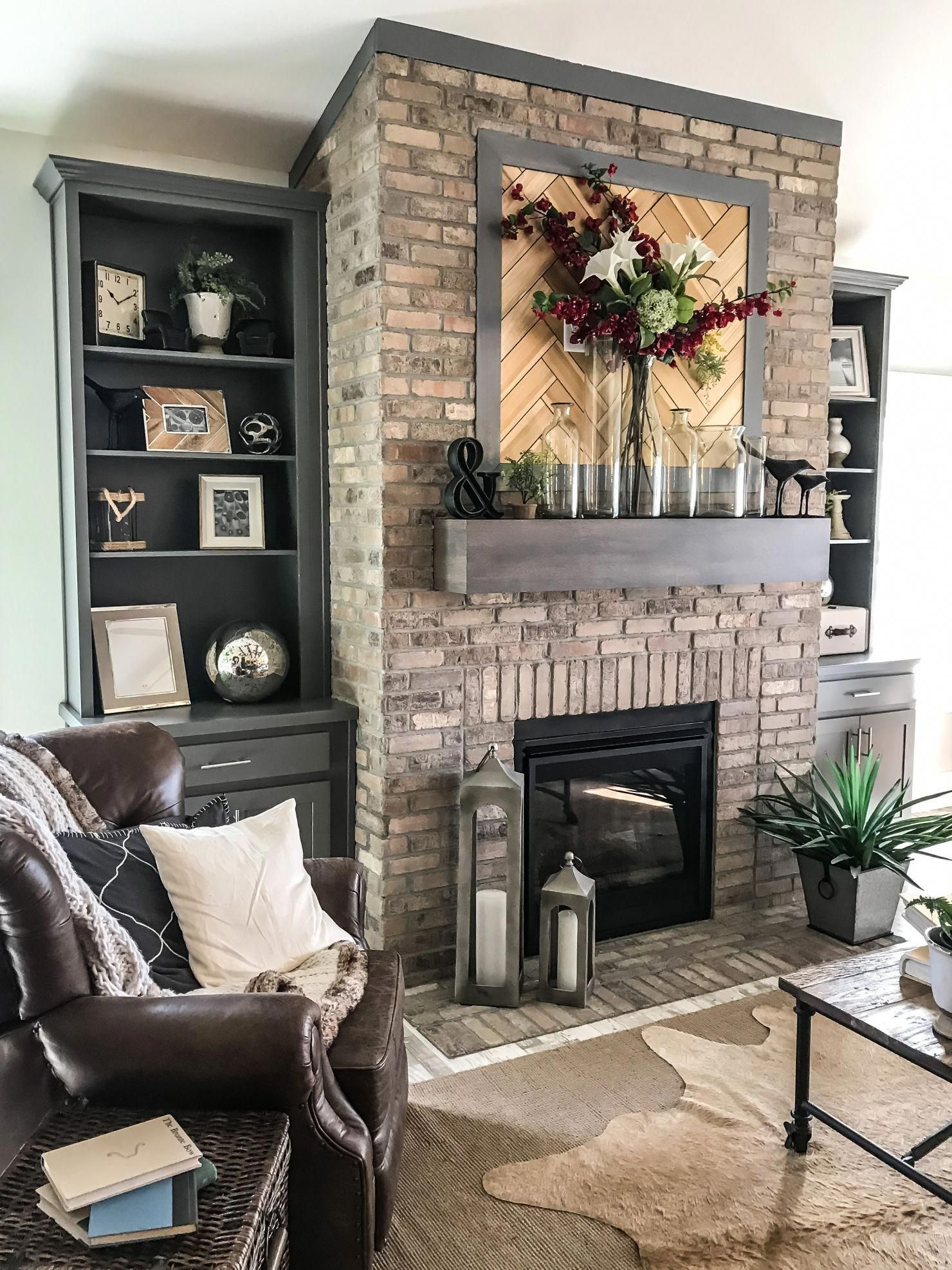 brick fireplace with floating mantle and natural