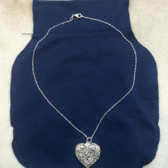 Heart necklace NWOT Beautiful heart silver toned fantasy jewelry necklace. Ask for measurements, any other pics or any other questions you may have Jewelry Necklaces
