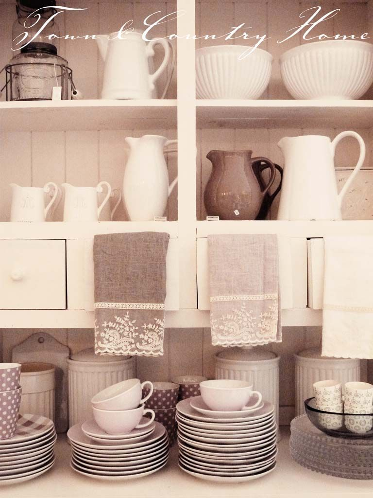 Lovely open shelving styled with shades of white and linen - different textures, patterns - polka dots and plaid