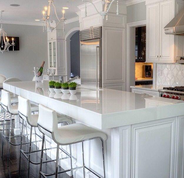 Sleek White Kitchen Modern Counter Stools Stainless Hood Thick