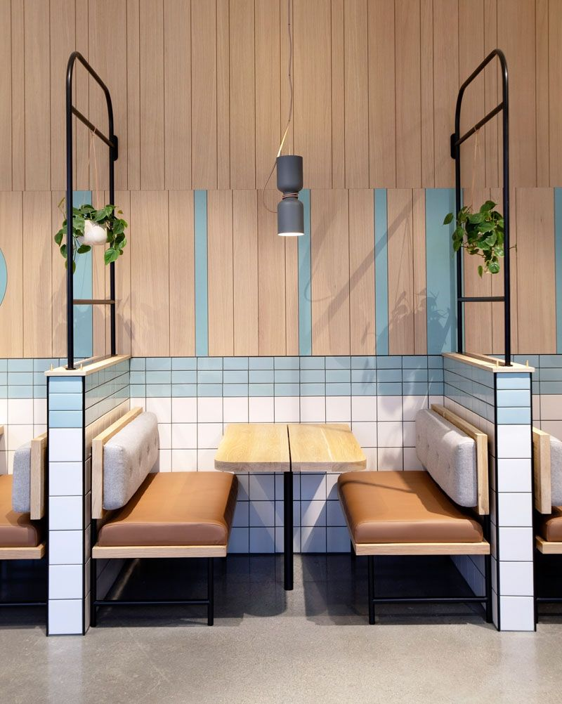 Restaurant Ideas - Black, tubular metalwork was used throughout the space as layering and framing elements to define seating areas whilst allowing the bright, open atmosphere to remain. #RestaurantIdeas #RestaurantDesign #RestaurantSeating #Booths