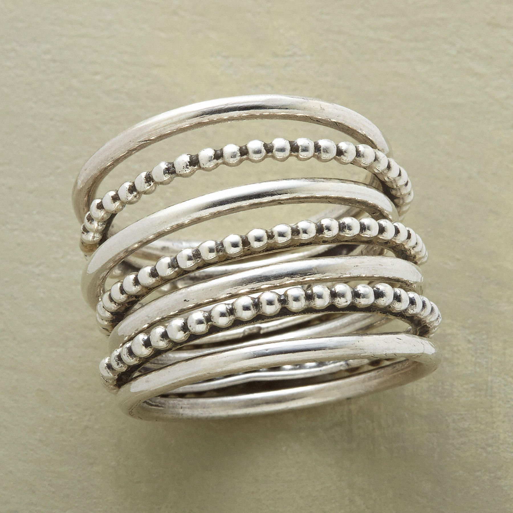 SEVEN BLESSINGS RINGS, SET OF 7--Wear the four smooth and three beaded oxidized sterling silver bands of our seven blessings spiral ring in any combination that pleases. Imported. Exclusive. Whole sizes 5 to 9. Set of 7.