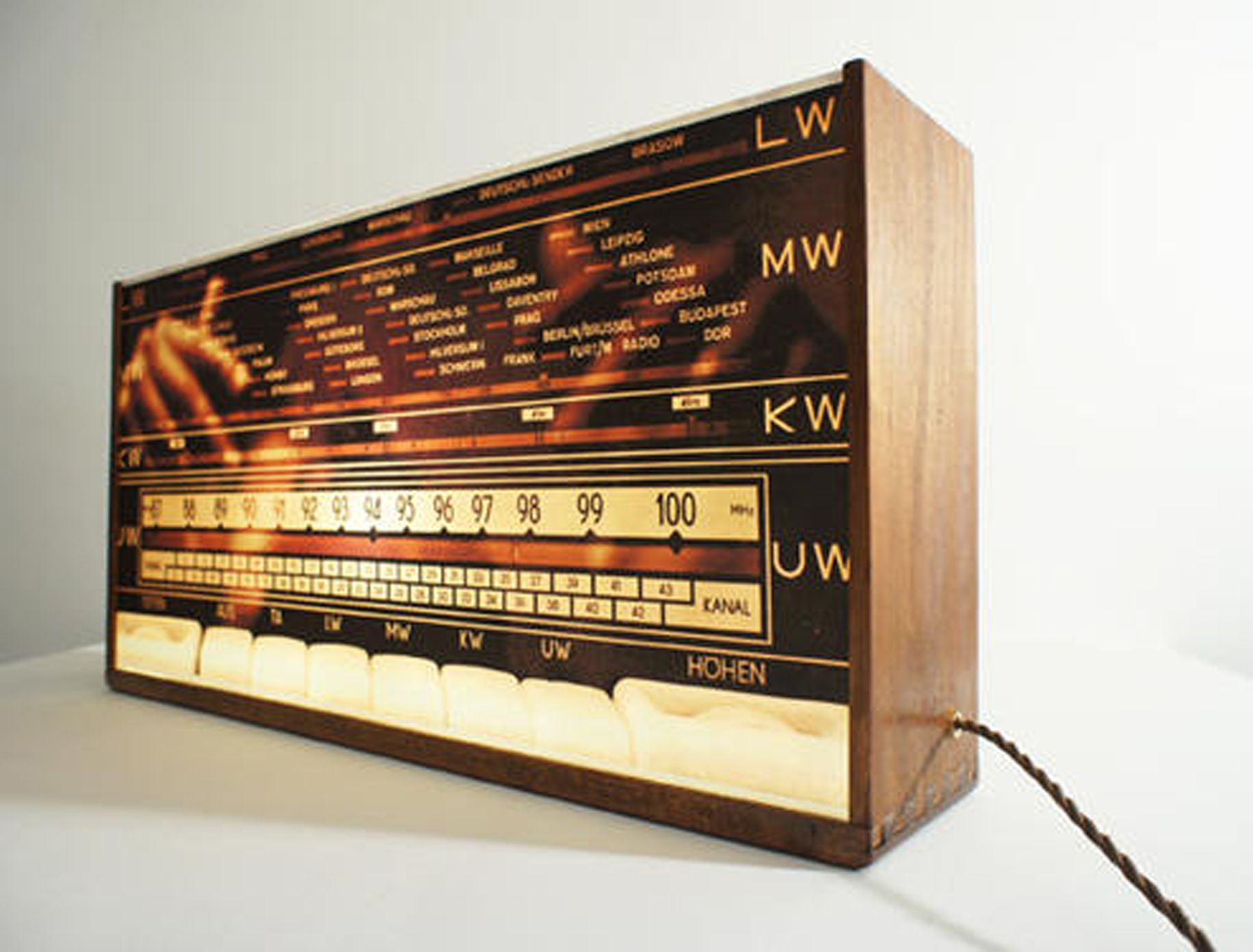 """Radio Symphony"" This Lightbox features the scale of an East German 1954 ""Pete"" vintage tube radio. Made from a dark oak drawer which dates back to 1943, it has been restored using its original features. It has a 3 core vintage twisted fabric cord in copper brown which is 3m in length. The brass lamp holder and brass card frame complete the overall piece http://www.wallsloveart.co.uk/shop/lights-lightboxes/radio-symphony-vintage-lightbox-wall-art"