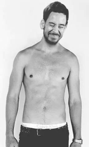 The Aquarius with shirtless slim body on the beach