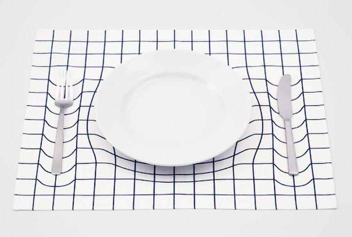‪#‎LIKEDbyPAPAFU‬ | 'Trick Mat' is a placemat that creates a warping grid illusion, cleverly mimicking the imagery of Albert Einstein's space-time fabric theory. Designed by A.P. Works, a Japanese design studio, the placemat immediately draws awareness to lingering questions about our presence in time and space. The many questions that this simple design provokes. The feelings that good design stimulates. A great, meaningful product! ‪#apworks #placemat #spacetime #alberteinstein…