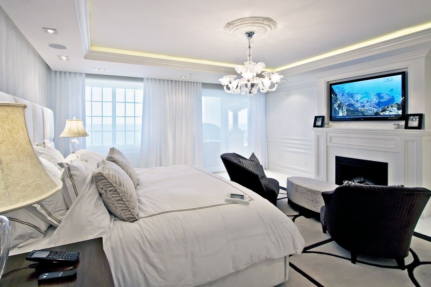 Beautiful Bedroom With In Ceiling Speakers And Tv Mounted Over Fireplace Ocean Overlook