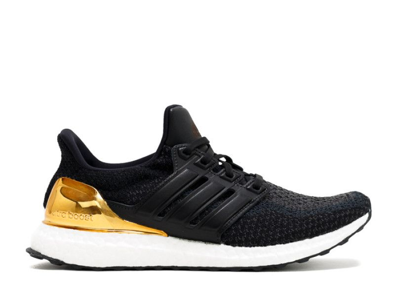 Adidas Ultra Boost in black/white/gold | $325