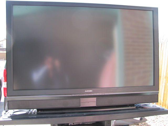 64 inch big screen mitsubishi tv in storage unit stuffed for Garage mitsubishi 95