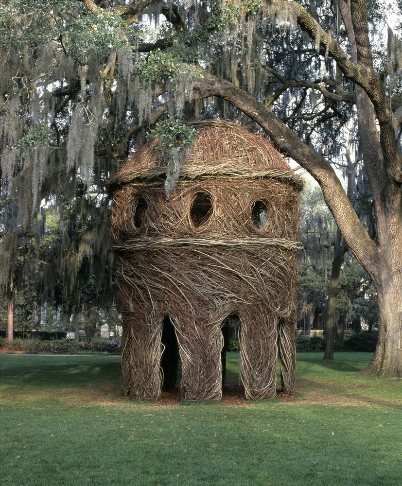 By weaving tree saplings and branches together, Dougherty creates majestic shelter sculptures.  Like willow domes or other arboreal structures.