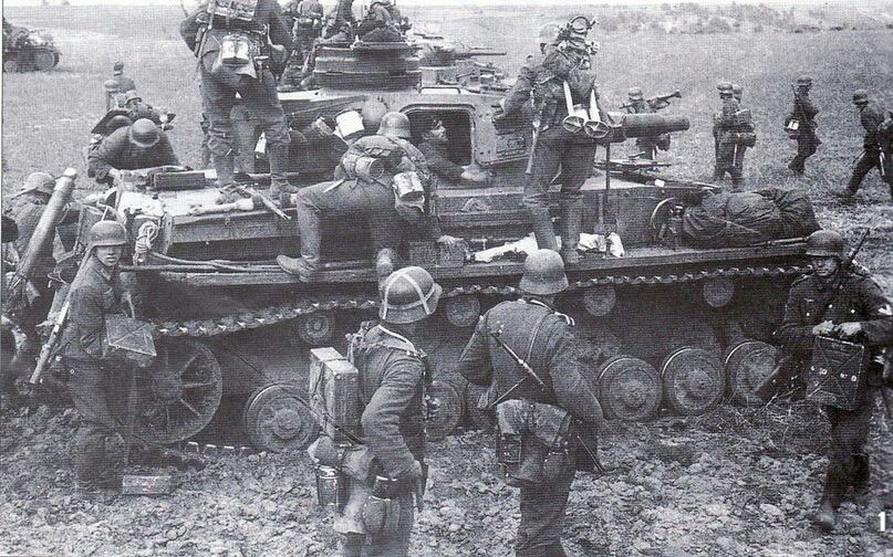 Ostfront. German troops hitch a ride on a Panzer III.