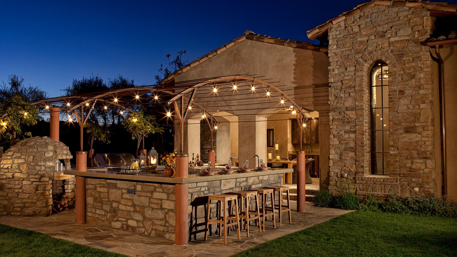 Stone outdoor kitchen pizza oven and patio with lights for Eldorado stone outdoor kitchen