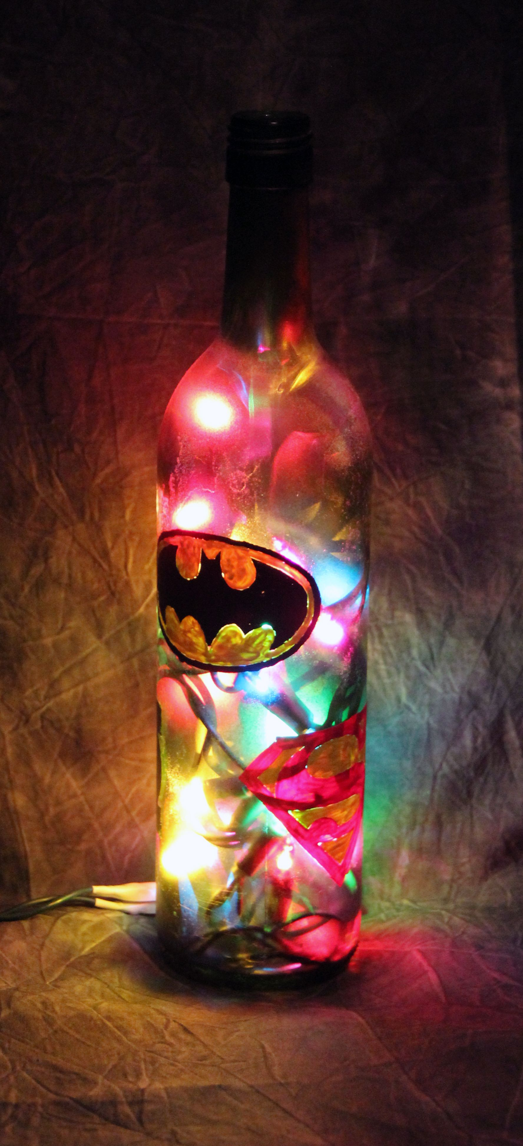 Small Wine Bottle with hand painted Batman, Superman and Green Lantern  logos frosted with multi