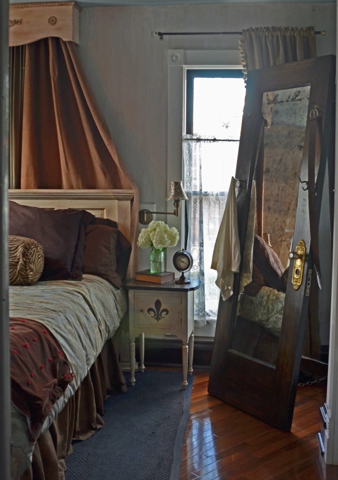 This bedroom features a standing mirror made from a vintage door. Bedroom design and & This bedroom features a standing mirror made from a vintage door ... Pezcame.Com