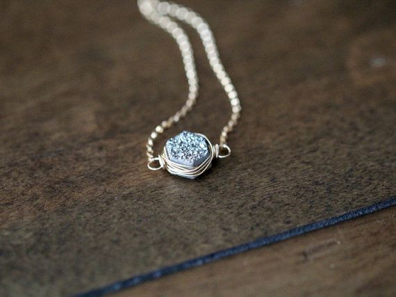 This simple everyday necklace features a gorgeous, high quality, custom cut hexagon Druzy Quartz in a Platinum gray shade. Its securely wrapped in
