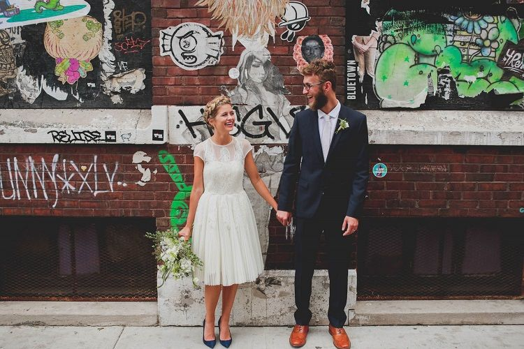 A short wedding dress and her braided crown hairstyle + something blue pumps | fabmood.com #rooftopwedding #shortweddingdress #weddingdress #bluepumps #blueshoes #bride