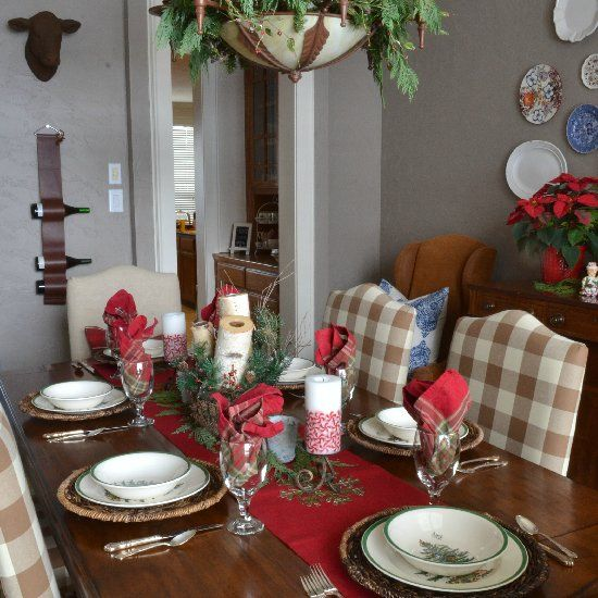 A casual, yet elegant, rustic Christmas tablescape featuring fresh and faux greens, bold reds and greens and cherished family collections.
