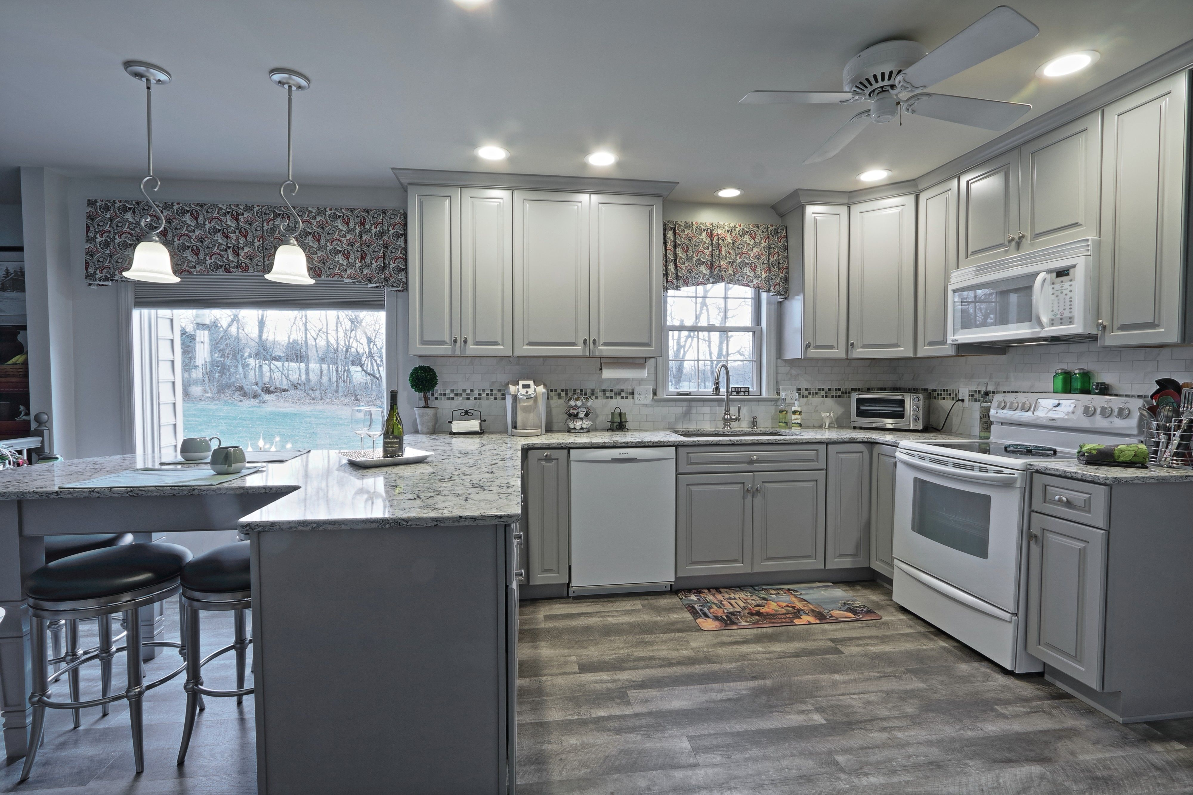 Gray Cabinets With Crown Molding Cambria Praa Sands Quartz Counters With An Attached Eating Area Mannington Adura Vinyl Plank Flooring Flooring Kitchen Redo
